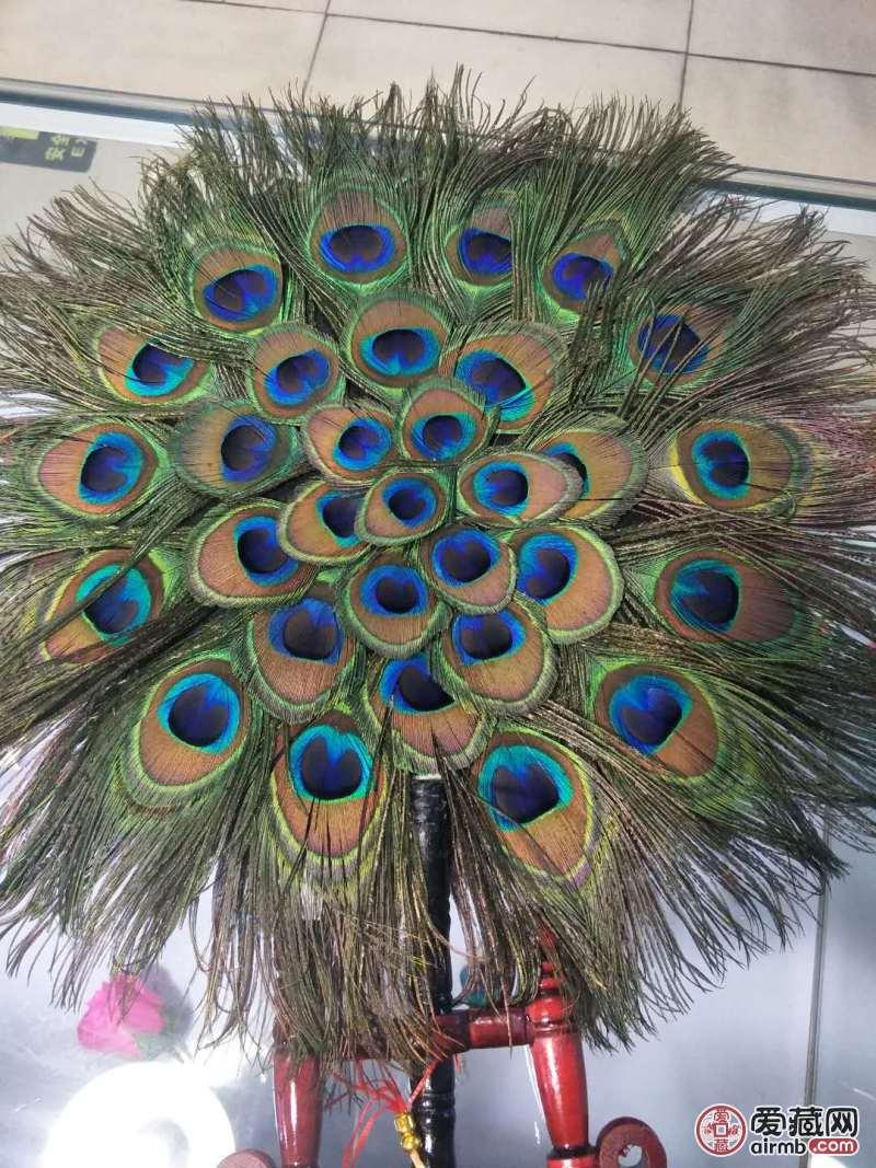 孔雀羽毛扇。纯手工制作,