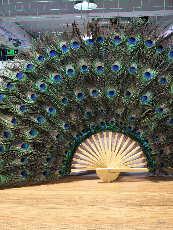 纯手工制作孔雀羽毛扇,采用5年